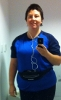 rmc28: Rachel, in running tshirt and leggings, holding phone and smiling into mirror (runner5)