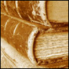 kaberett: Photo of a pile of old leather-bound books. (books)