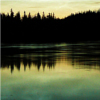 kohikari: bright clouds silhouetting the forested skyline, and reflecting on a still lake (mirror)