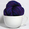 shatteredshards: a large cappuccino cup with a skein of multicolored yarn in it (cuppa yarn)