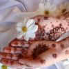 recessional: hennaed hands holding a flower (personal; hands of light)