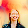 purpleyin: Brightly coloured background with Olivia Dunham looking happy and smiley (light)