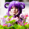 hippyjolteon: Purple-haired girl looks over a spray of flowers. (Ratatta Girl: Flowers)