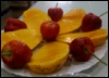 afuna: strawberries and mangos arranged on a plate (fruits I have them)