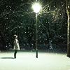 crystal_clear: a girl looking up at a lit lamp post, in the middle of a night (seeing the light)