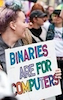 "tim: A person with multicolored hair holding a sign that says ""Binaries Are For Computers"" with rainbow-colored letters (binaries)"