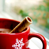 sholio: Cocoa in red cup with cinnamon stick (Christmas cocoa)