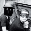 rydra_wong: Lee Miller photo showing two women wearing metal fire masks in England during WWII. (Default)