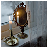 alee_grrl: Candle burning next to mirror in a window sill with snow seen through the window (Winter candle)