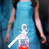 spatz: miniseries Alice approaches a vial of red liquid (Alice curiosity killed the cat)