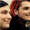 were_duck: closeup of Frank and Gerard, smiling to the right, Gerard with red hair and ugly scarf (Frank and Gee smiles)