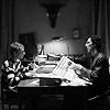 elaineofshalott: Still of John (Martin Freeman) and Sherlock (Benedict Cumberbatch) sitting in their living room, with a newspaper. (morning paper 3)