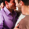 ryanloveless: two 30-something men facing each other, embracing (facing, purple shirt)
