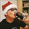 coreopsis: Matt Skiba wearing a santa hat drinking beer from can (santa!Matt)