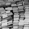 musyc: Black and white image of multiple stacks of books (Books: So many books)