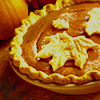 sylvaine: Pie with dough decoration in the shape of leaves; a pumpkin in the background ([gen] autumn pie)