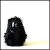 kate_nepveu: small black cartoon creature with unevenly-sized eyes and thin smile; effect is meant to be friendly but odd (slightly crazed, Err . . . hi)