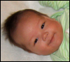 kate_nepveu: infant lying down and smiling, front view (SteelyKid - smile from top (2008-10))