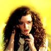 language_escapes: Annabelle on the phone, yellow background (On the Phone)