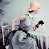 fascination: A woman dressed in 1930s-style clothing (Historical)