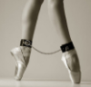 derridian: ballerina en pointe with ankles chained together (ballet)