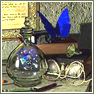 branchandroot: butterfly on a desk with a world in a bottle (butterfly glass desk)
