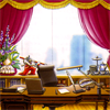 attorneys_at_law: Edgeworth's office.  A desk in front of a large window with pink curtains and knickknacks all around. (default)