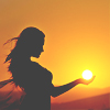 dchan: A silhouette of a woman appearing to hold the sun in her hands (hold the sun in my hands)