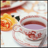 loveandwar: A porcelain teacup on a table with a rose (Everything I am)