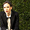 labellementeuse: a woman (Ellen Page) in a suit against a green background (inc ellen page looks hot in a suit)
