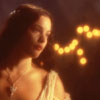 muccamukk: Arwen in a white dress in the candlelight. (LotR: Evenstar)