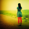 fascination: A woman walking into a hazy, brightly coloured dreamscape of a place. (Journeying elsewhere.)