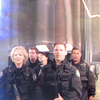 skieswideopen: Sam, Daniel, Vala, Cam, and Teal'c in black uniforms (SG: SG1 Team)