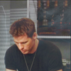 skieswideopen: Cam in a black t-shirt, looking down (SG: Cam)