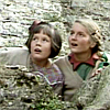 labellementeuse: lucy and susan pevensie, on a wall, looking up with awed expressions (narnia sistren)