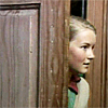 labellementeuse: a blonde girl (susan pevensie) peeking around a door (narnia susan opens the other door)