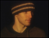 josephine_marrs: Colin Morgan wearing a dark-colored beanie, apparently at night (pic#)