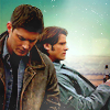lilyleia78: Dean standing in front of Sam, leaning on Impala (Supernatural: Brothers)