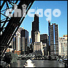 "celli: several Chicago buildings as seen from under a raised-up bridge, captioned ""chicago"" (Chicago)"