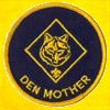 "celli: a Cub Scout badge that says ""den mother"" (fannish den mother)"