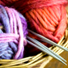 alexseanchai: Purple-pink and red yarn in basket with knitting needles (knitting)