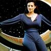 skygiants: Jadzia Dax lounging expansively by a big space window (daxanova)