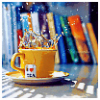ladylunas: a cup of splashing tea with books in the background (tea and books)