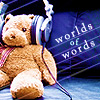 "yue_ix: Plush bear with hearphones and the words ""world of words"" (Podfic: world of words)"