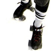 lasergirl: feet wearing roller skates, ready to roll (derby girl)