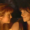 eruthros: Xena and Gabrielle looking at each other in the dark (Xena - looking at each other)