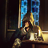 annariel: Picture of Aragorn from the Lord of the Rings movie as he first appears, sitting in a corner, hooded and smoking a pipe. (Tolkien:Aragron)