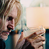 muccamukk: Haymitch staring morosely into his drink. (HG: Drowning Sorrows)