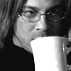 kate: Eliot from Leverage, with his mug of coffee, right before he takes down a room in the dark. :) (Leverage: Eliot disguised as Daniel Jack)