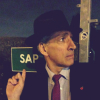 diabolicalfiend: Miles Richardson, looking concerned that the sign saying 'SAP' means him. (miles richardson, sap for hat)